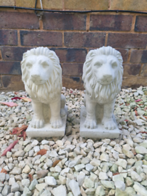 Pair stone lion statues