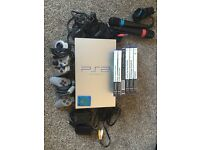PlayStation 2 with Singstar microphones and original game