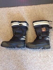 Used winter steel toed boots