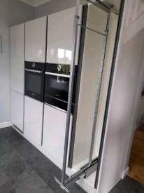 Pull out larder fitting for kitchen unit