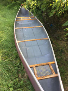 16 foot canoe with 3 paddles and 2 life jackets