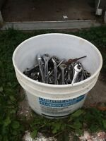 Bucket of socket wrenches and sockets