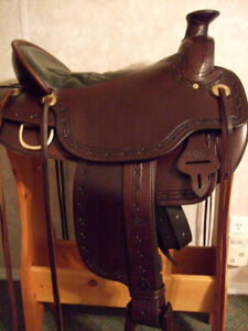 WELL BUILT TUCKER WESTERN SADDLE FOR SALE.c
