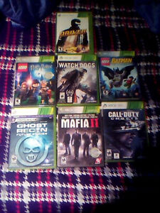 Xbox 360 with 7 games cords a controller and headset London Ontario image 2