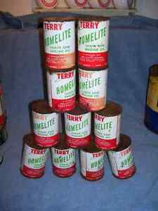 Several Terry Homelite Chain Saw Engine Oil Tin Can