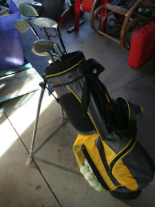 Junior set of Golf clubs with bag and approx 300 golf balls