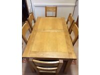 Extending oak table and 6 chairs