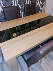 Dining table wooden with glass centre panel and four chairs