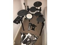 Yamaha DTX502 electronic drum kit with double bass pedal