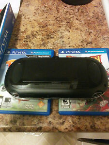 PS Vita in box with four game's