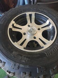 4 mint condition tires and rims off a Arctic cat atv