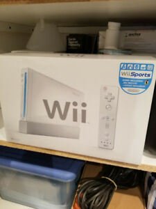 Nintendo Wii with 2 controllers & 2 nunchuk's plus 1 game