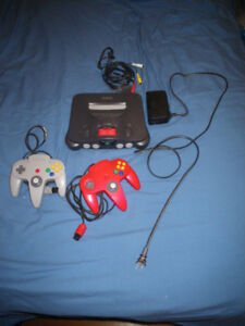 Nintendo 64 Console, two controlers  and 9 Games