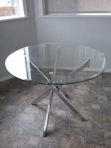 Almost new glass dining table, chrome legs