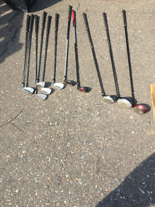 11 Golf Clubs for sale...various irons and drivers