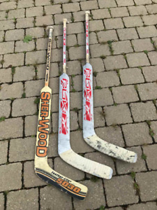 GENTLY USED WOODEN HOCKEY GOALIE STICKS