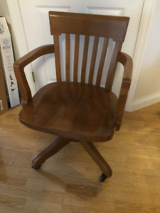old wooden office chair on wheels