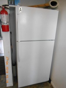 Kenmore Refrigerator with Freezer Compartment.