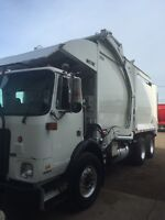 2009 AUTOCAR FRONT LOAD GARBAGE TRUCK