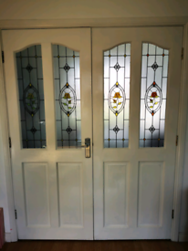 £70 for double doors, solid wood, part ornamental glazed.