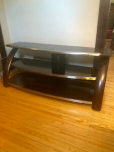 Glass tv stand 54 inches across and 22 high.