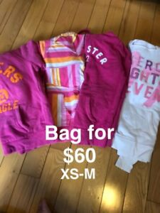 Bag of ladies tops and sweaters