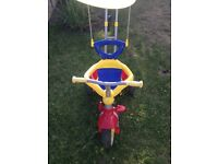 Toddle tricycle with parents handle and a canapé