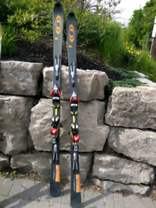 Two pairs of Skis, boots and poles