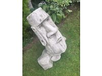 Large stone garden Easter island head statue. New