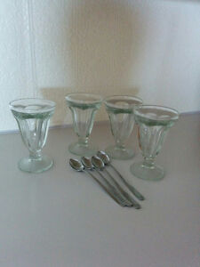 Ice cream sundae glasses and spoons
