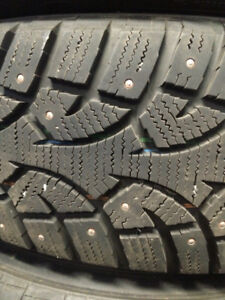 Studded 225/65R17 tires with brand new steel rims.