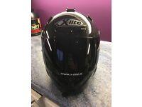 X-lite carbon fibre motorbike helmet . Size large .