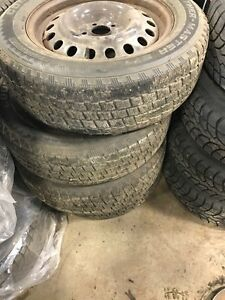 Four used studded winter tires and rims