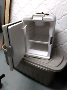 Coleman 12v electric cooler. Warms as well.