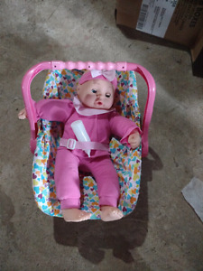 Like new baby doll with carrying chair