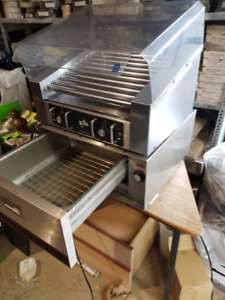 hot dog roller . folding leg tables grid wall panels . stainless
