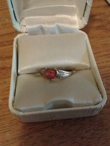 HEART SHAPED RUBY WITH A DIAMOND ON EACH SIDE OF THE HEART
