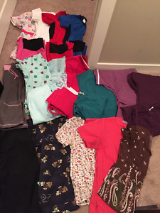Assorted small and extra small scrubs tops and bottoms