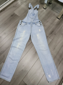Pale denim dungarees with faded ripped detailing Primark size 8