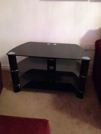 Immaculate black glass tv stand