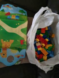 Mixed bag of lego duplo and play mat