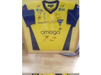 Framed signed Warrington wolves shirt