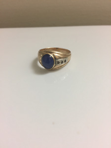 14k solid gold with sapphire stone and diamond chips