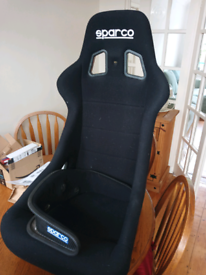 Sparco bucket seat and carbon head restraint