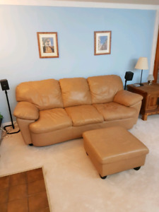 Leather couches and foot stool