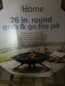 26 inch steel fire pit with case, brand new
