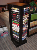 REVOLVING TOWER FULL OF VHS MOVIES.............  ALSO FITS DVDS