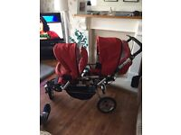 Immaculate Jane power twin pushchair in red