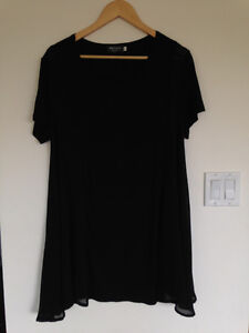 Black long top size large with sheer panels