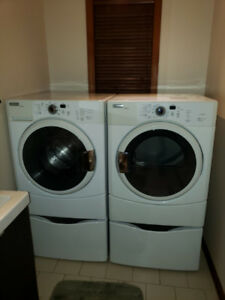 Washer and dryer on pedestals
